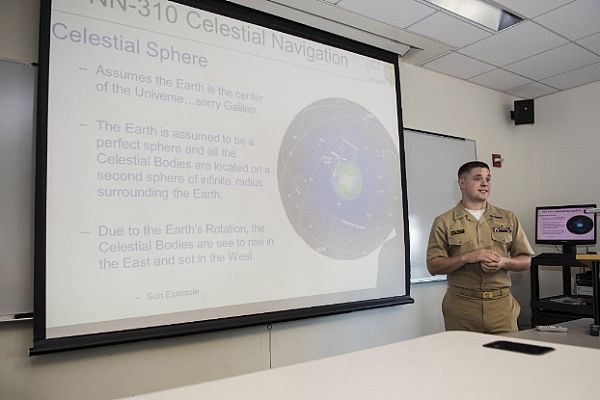 151015-N-XL102-049  ANNAPOLIS, Md. (Oct. 15, 2015) Lt. Daniel Stayton gives classroom instruction on celestial navigation (CELNAV). The Naval Academy reinstated CELNAV classroom instruction during the summer session of 2015. The Class of 2017 will be the first in many years to graduate with a basic knowledge of CELNAV. (U.S. Navy photo by Mass Communication Specialist 2nd Class Tyler Caswell/Released)